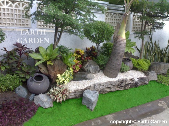 Tropical backyard landscaping ideas home design elements for Pocket garden designs philippines